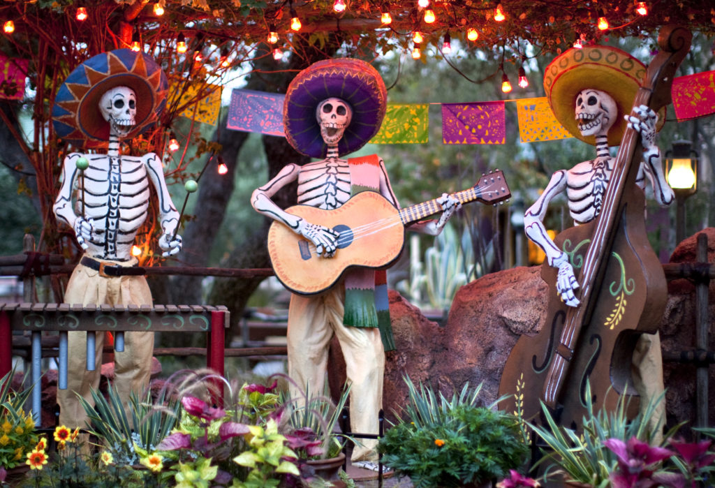 """DIA DE LOS MUERTOS (ANAHEIM, Calif.) – A colorful display at Disneyland park honors Dia de los Muertos with cheerful skeletons, sugar skulls and marigolds during Halloween Time at the Disneyland Resort, from Sept. 9 through Oct. 31 2016. The Halloween season features seasonal entertainment and décor, in addition to the return of Haunted Mansion Holiday and Space Mountain Ghost Galaxy. This year, the family-friendly Mickey's Halloween Party will be held on 17 nights at Disneyland Park, where guests are invited to trick-or-treat in costume, celebrate with favorite Disney characters and enjoy the """"Halloween Screams"""" fireworks spectacular. (Paul Hiffmeyer/Disneyland Resort)"""